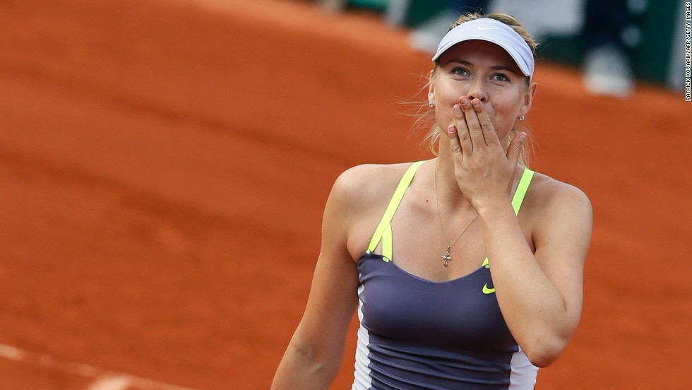 Maria Sharapova of Russia celebrates after beating Su-Wei Hsieh of Taiwan 6-2, 6-1 in the first round of the French Open on May 27.