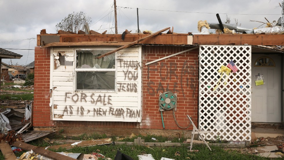 """A message is left by a homeowner who lost his home in the May 20 tornado on Monday, May 27, in Moore, Oklahoma.  <a href=""""http://www.cnn.com/2013/05/20/us/gallery/midwest-weather/index.html"""">View more photos of the aftermath in the region</a> and another gallery of <a href=""""http://www.cnn.com/2013/05/21/us/gallery/oklahoma-tornado-aerials/index.html"""">aerial shots of the damage</a>."""