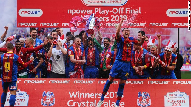 Crystal Palace players celebrate their return to the Premier League after an absence of eight years.