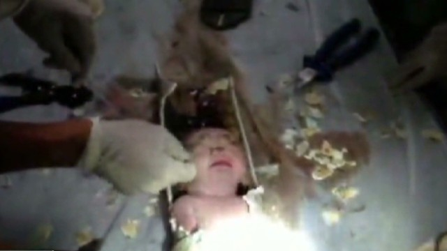 Saving a newborn trapped in sewer pipe