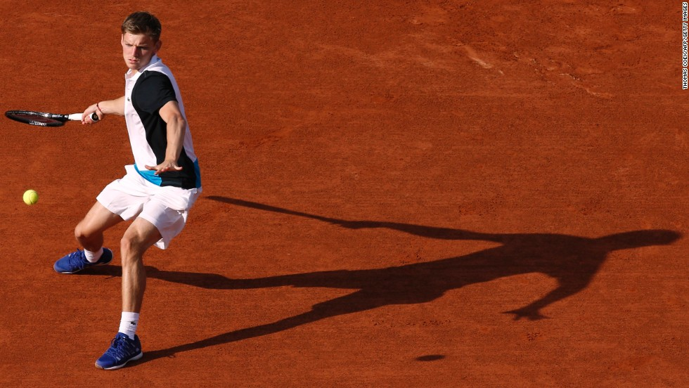 Belgium's David Goffin hits a forehand to Serbia's Novak Djokovic during a first round match of the French Open at Roland Garros Stadium in Paris on Tuesday, May 28.
