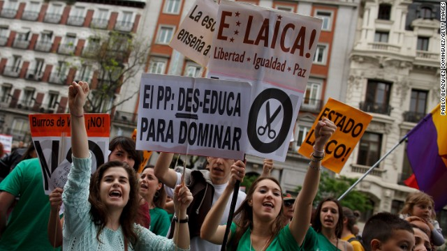 (File photo} Protesters demonstrate against education cuts and reforms on May 9, 2013 in Madrid, Spain.