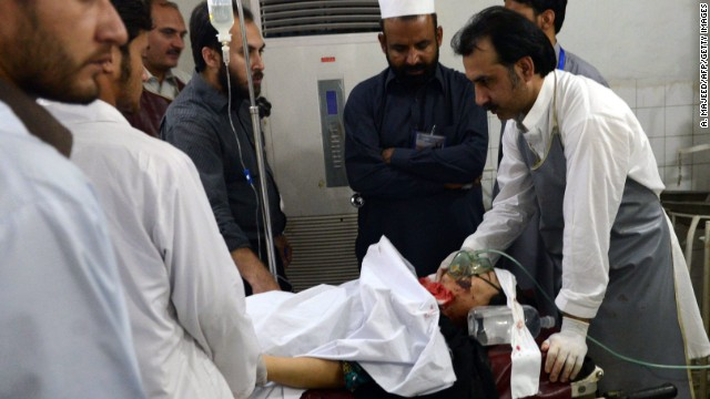 Paramedics treat an injured polio health worker at a hospital following an attack by gunmen in Peshawar on Tuesday,