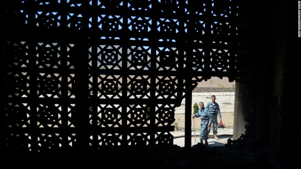 "MAY 29 - BAZARAK, AFGHANISTAN: Defense personnel inspect the scene of a <a href=""http://cnn.com/2013/05/29/world/asia/afghanistan-violence/index.html"">suicide attack on the Panjshir governor's office</a>. The attack in one of the country's stable regions raises questions about <a href=""http://globalpublicsquare.blogs.cnn.com/2013/04/25/why-we-should-be-optimistic-about-afghanistan/"">the country's future after the withdrawal of NATO-led troops in 2014</a>."