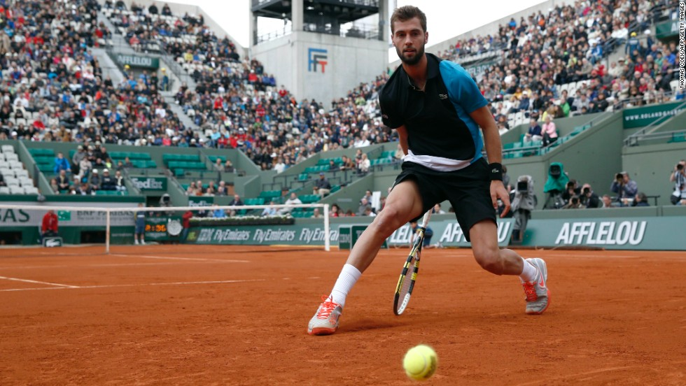 France's Benoit Paire misses a shot from Cyprus' Marcos Baghdatis on May 29. Paire defeated Baghdatis 3-6, 7-6(1), 6-4, 6-4.