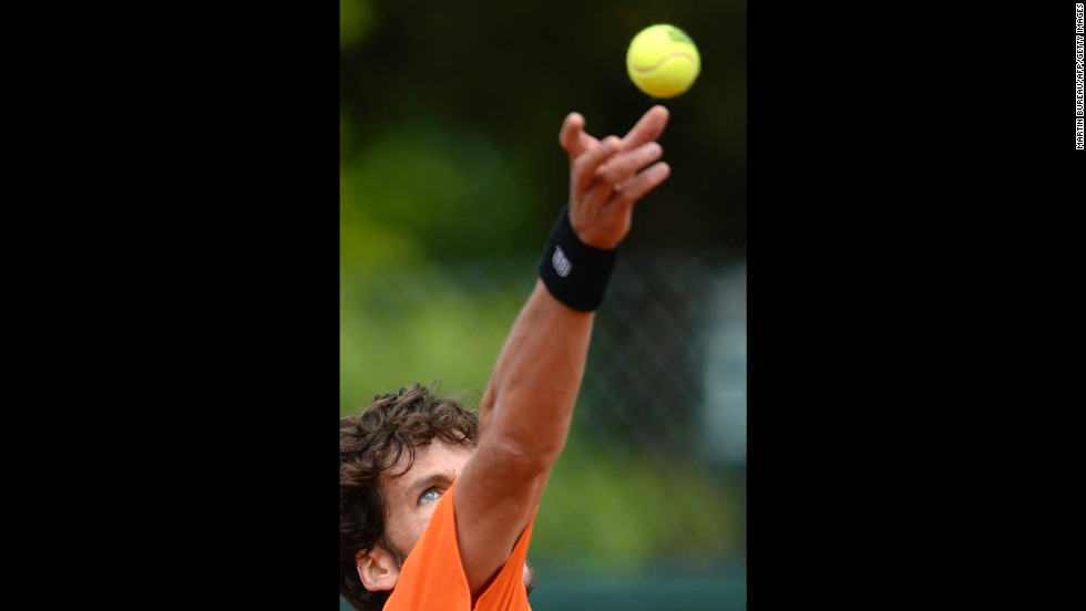 Spain's Feliciano Lopez serves to Portugal's Joao Sousa on May 29. Lopez won 3-6, 6-3, 6-4, 6-4.