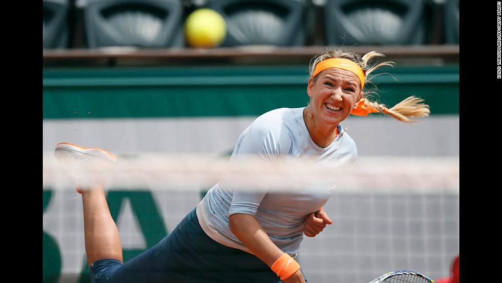 Belarus' Victoria Azarenka serves to Russia's Elena Vesnina on May 29.