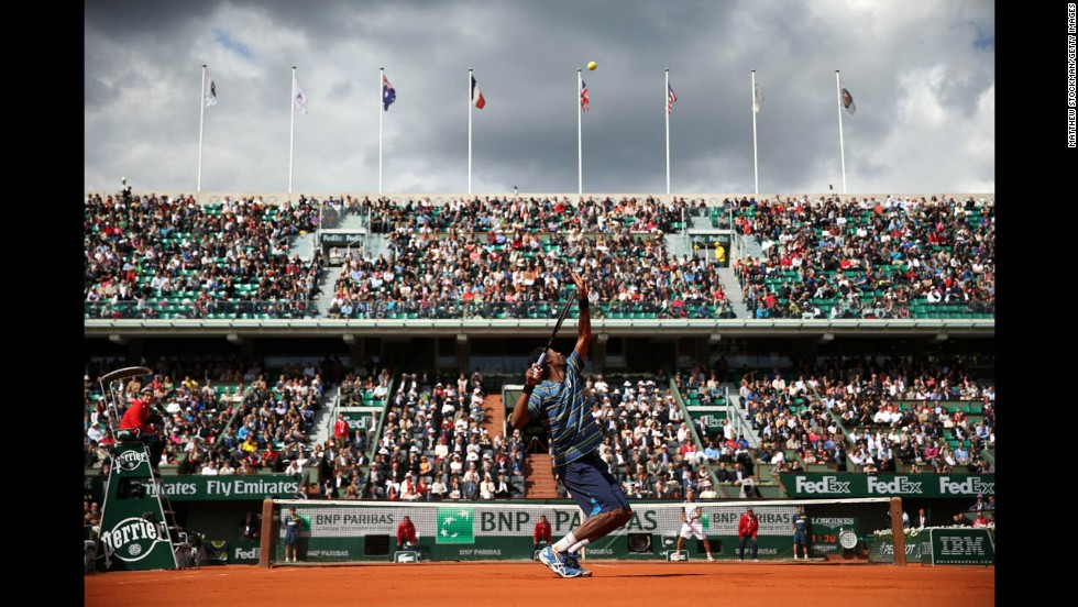 Gael Monfils of France serves against Ernests Gulbis of Latvia on May 29. Monfils beat Gulbis 6-7(5), 6-4, 7-6(4), 6-2.