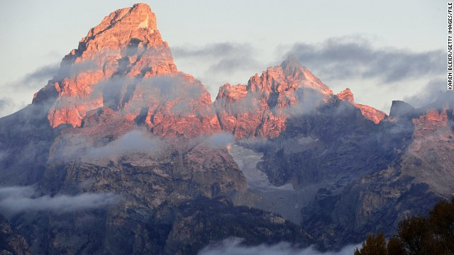It's another morning at the Grand Teton National Park, where tthe morning sun hits the tips of the Grand Tetons.