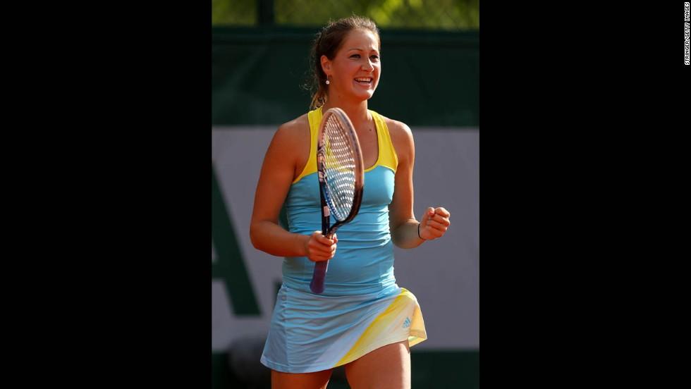 Bojana Jovanovski of Serbia celebrates match point against Caroline Wozniacki of Denmark on May 29.