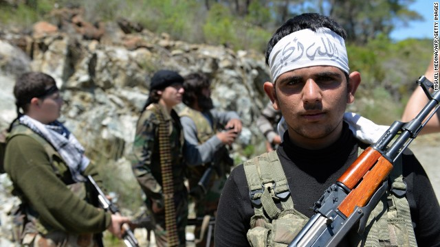 Rebel fighters from the Al-Ezz bin Abdul Salam Brigade train near the al-Turkman mountains in Syria.