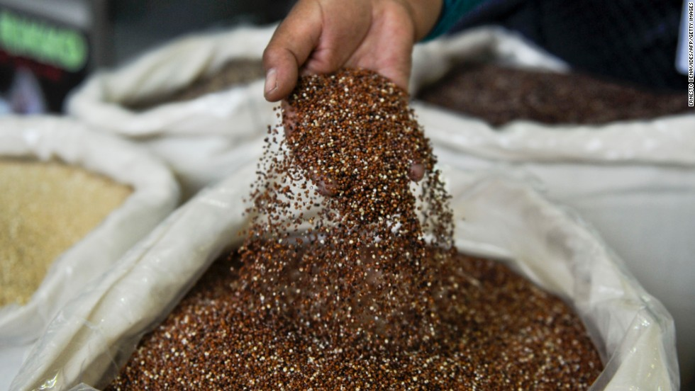 A vendor shows quinoa, a grain-like crop, during the Mistura food festival in the Peruvian capital of Lima.