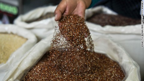 A vendor woman shows quinoa, a grain-like crop, during the Mistura food festival in the Peruvian capital of Lima on September 6, 2012.