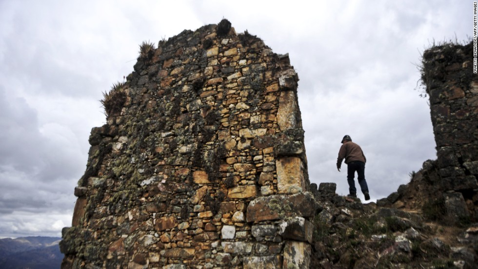 A tourist visits the pre-Incan ruins at the Marcahuamachuco archaeological site in the highlands of La Libertad.