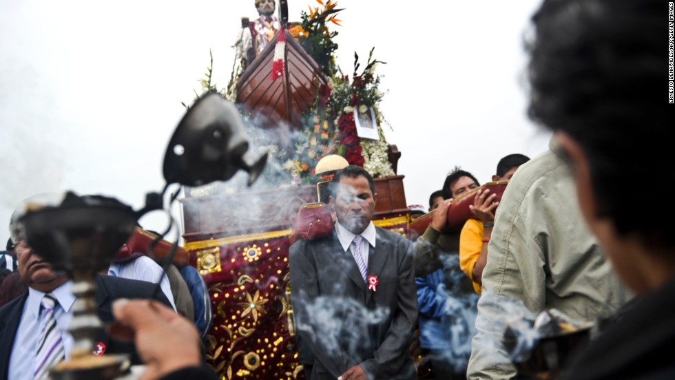 Catholics take part in a procession carrying an image of St. Peter, the fishermen's patron saint, at the port of Chorrillos.