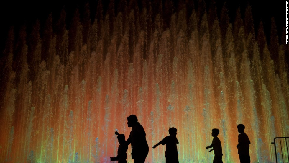Children play in front of one of the fountains at the Parque de la Reserva in Lima.