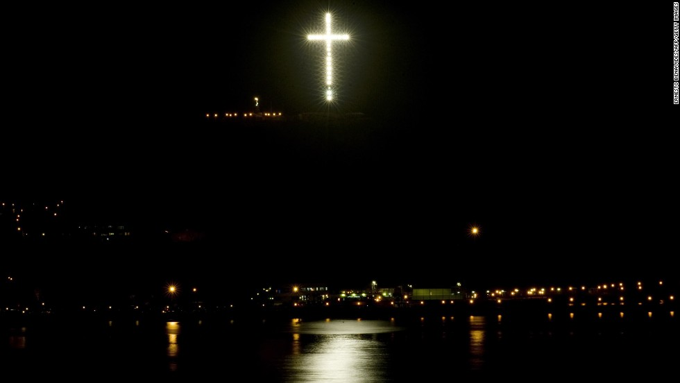 "An illuminated cross, ""La Cruz del Morro,"" lights up the sky in Lima on February 23, 2010. It was built using the remains of electricity towers destroyed by Shining Path guerillas in the 1980s. Its construction coincided with Pope John Paul II's visit to the country in 1988."