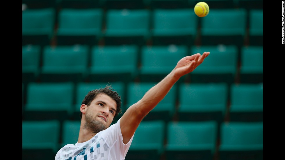 Bulgaria's Grigor Dimitrov serves to France's Lucas Pouille on May 30.