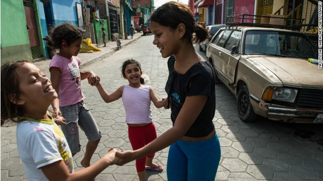 Girls play in a paved street in Uniao de Vila Nova, recently converted in the framework of a favela upgrading project