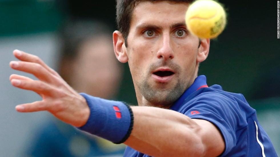 Serbia's Novak Djokovic prepares a shot to Argentina's Guido Pella on May 30.