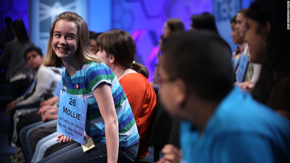 "Mollie J. Symons of Halifax, Nova Scotia, Canada, returns to her seat after spelling ""ombrology,"" a branch of meteorology dealing with rain, in round three on May 29."