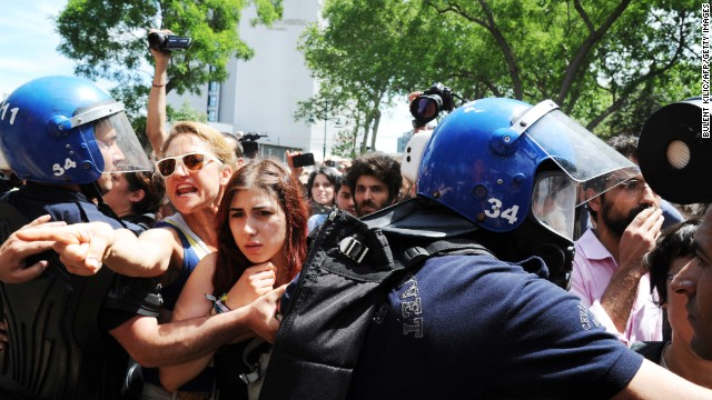 Turkish riot policemen clash with protesters at the Taksim Gezi Park in Istanbul on Tuesday.