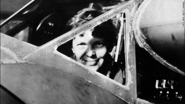 In a photo taken in the 1930s, Amelia Earhart looks trough the cockpit window of her plane.