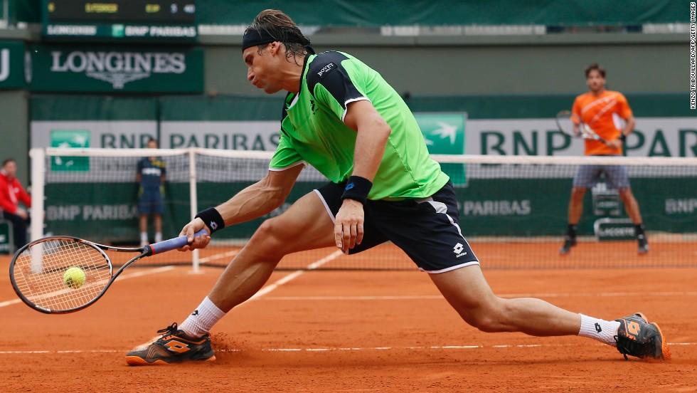 Spain's David Ferrer returns to Spain's Feliciano Lopez on May 31. Ferrer won 6-1, 7-5, 6-4.
