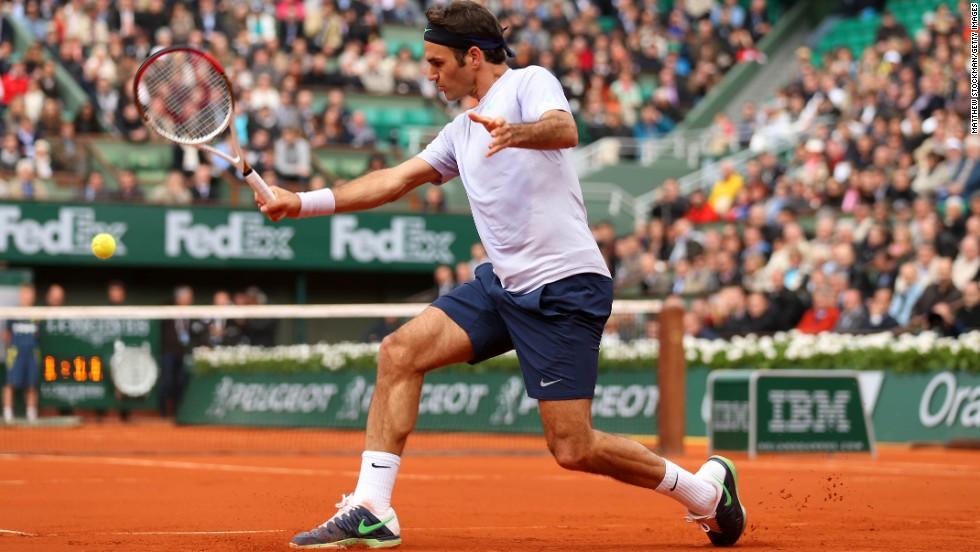 Roger Federer of Switzerland plays a backhand against Julien Benneteau of France on May 31. Federer won 6-3, 6-4, 7-5.