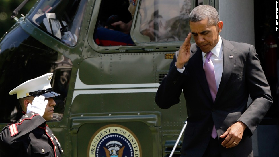 President Barack Obama salutes as he returns to the White House after a trip to Chicago on Thursday, May 30. Federal authorities searched the home of a Texas man on Friday in connection with an investigation into threatening letters, possibly tainted with ricin, that were sent to Obama.