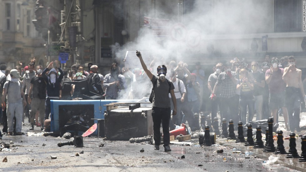 Turkish protesters wearing gas masks face off against riot police near Istanbul's Taksim Square on June 1.