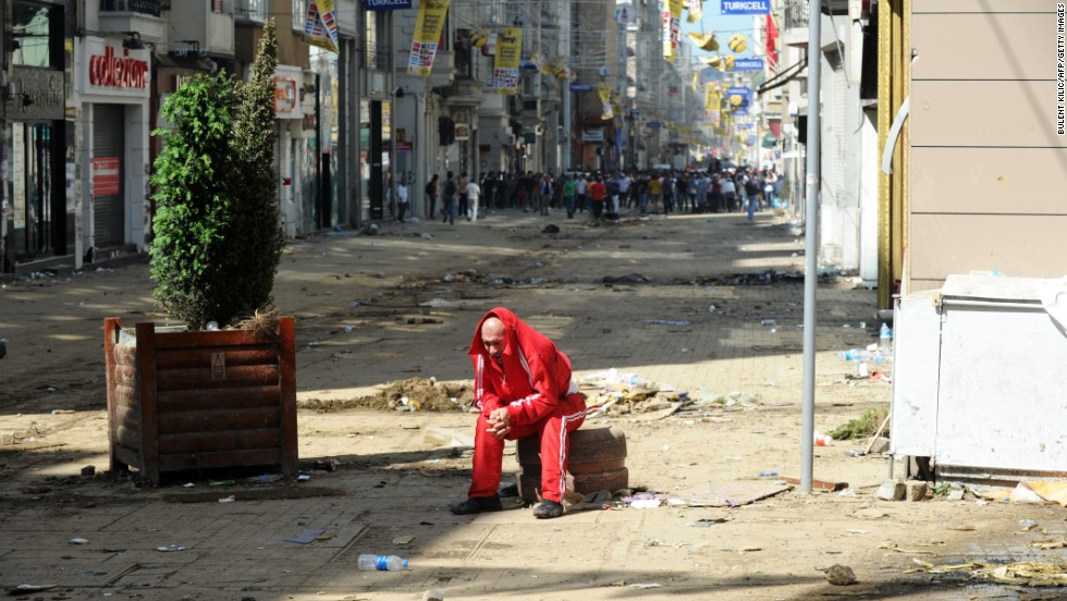 A man catches his breath behind the line where clashes are taking place on June 1.