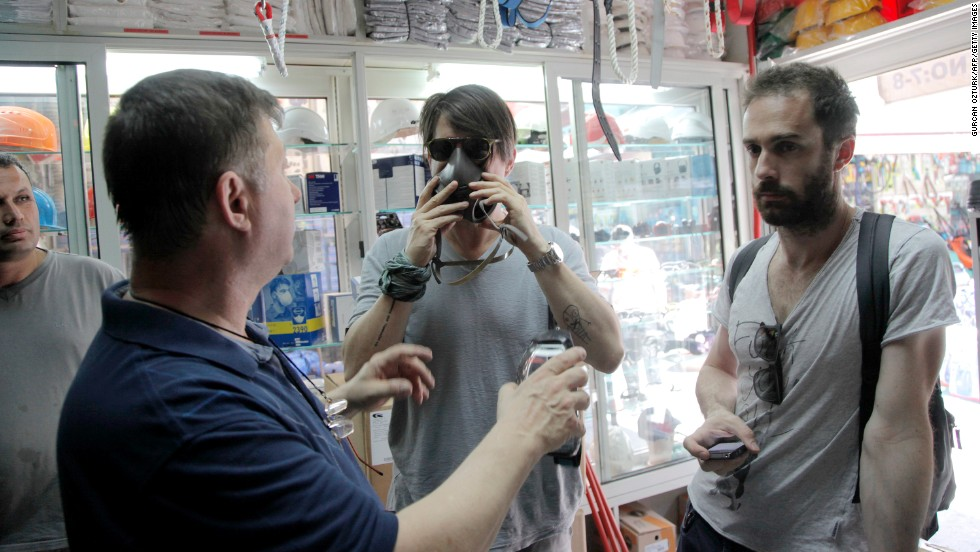 Protesters buy gas masks from a local shop near the square on June 1.