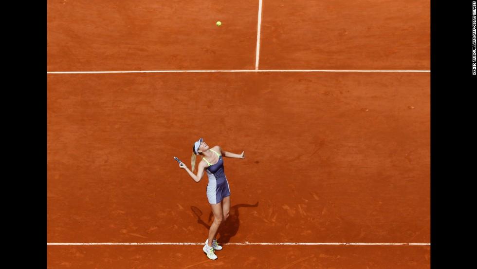 Russia's Maria Sharapova serves to China's Jie Zheng during the third round match June 1. Sharapova won 6-1, 7-5.