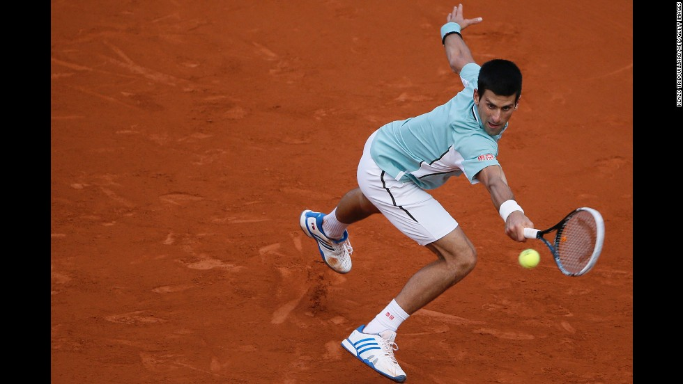 Serbia's Novak Djokovic returns the ball to Bulgaria's Grigor Dimitrov on the seventh day of the French Open on Saturday, June 1. Djokovic won 6-2, 6-2, 6-3.