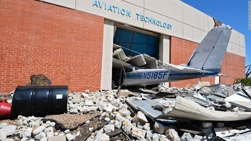 The tail section of a plane juts out of a crumbling building at a technology school in El Reno on June 1.