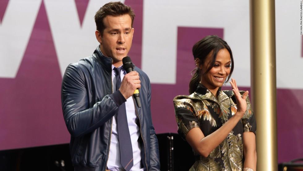 Ryan Reynolds and Zoe Saldana address the audience.