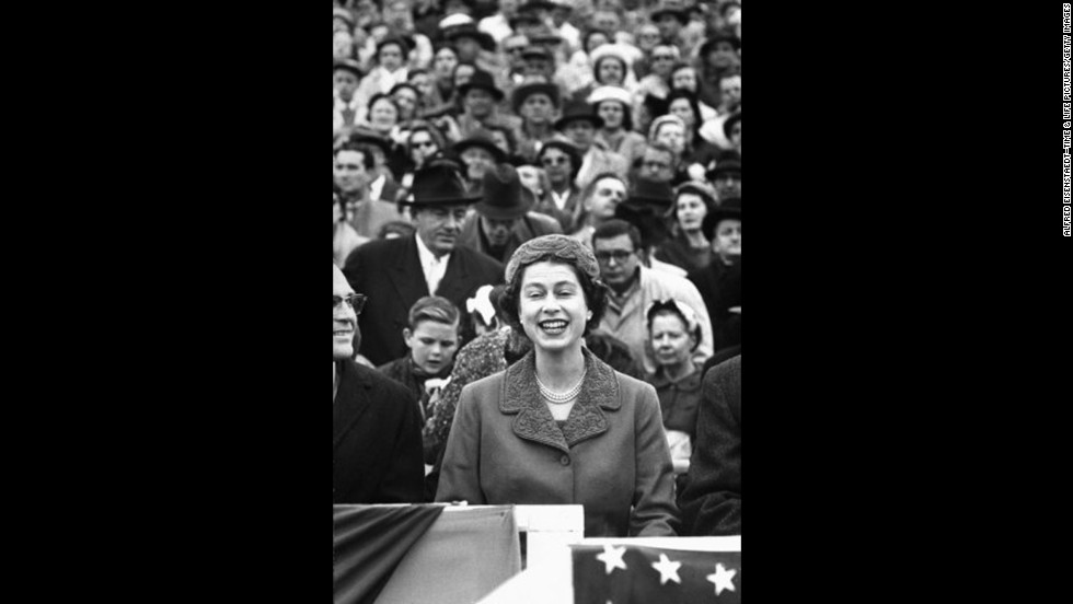 Queen Elizabeth II watches a University of Maryland vs. University of North Carolina football game at Maryland's Byrd Stadium during her 1957 official visit to the United States.