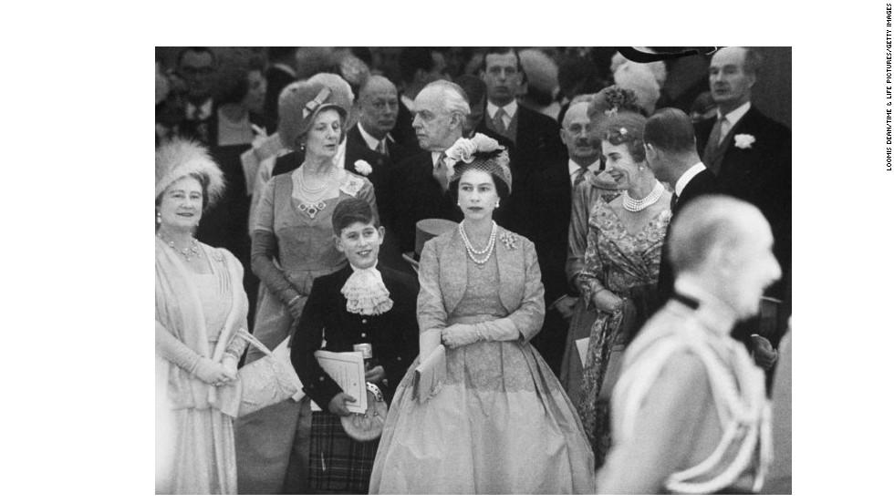Queen Mother Elizabeth, from left, Prince Charles and Queen Elizabeth II attend Princess Margaret's wedding in 1960.