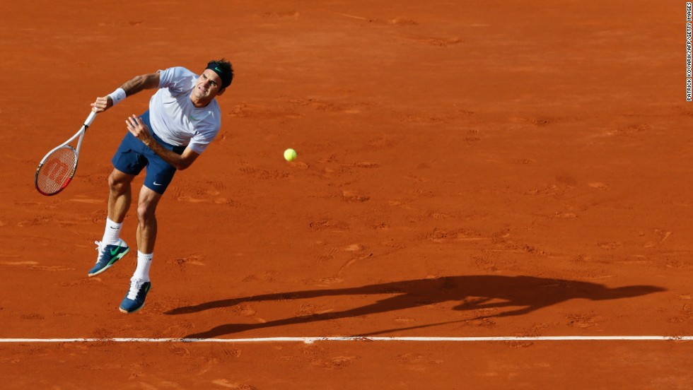 Switzerland's Roger Federer serves to Gilles Simon of France during a fourth-round match of the French Open on Sunday, June 2, in Paris. Federer defeated Simon 6-1, 4-6, 2-6, 6-2, 6-3.