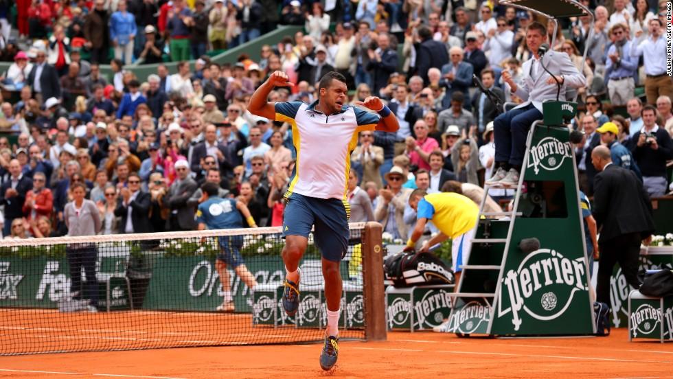 Jo-Wilfried Tsonga of France celebrates singles win on June 2, beating Viktor Troicki of Serbia 6-3, 6-3, 6-3.
