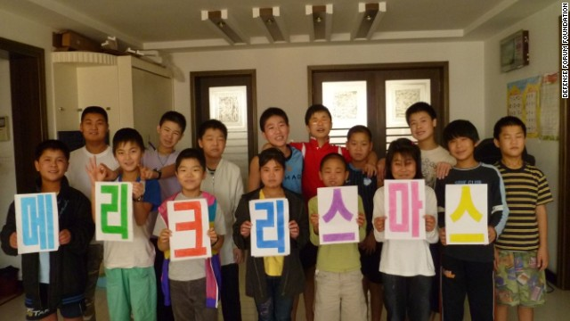 A Christmas 2011 photo shows North Korean youth refugees, nine of whom were handed last week to North Korean authorities.