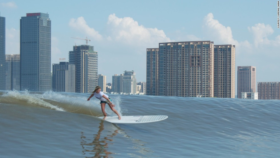 "Each year, international surfers compete on Qiantang River, riding the ""Silver Dragon"" wave, which flows through the city of Hangzhou."