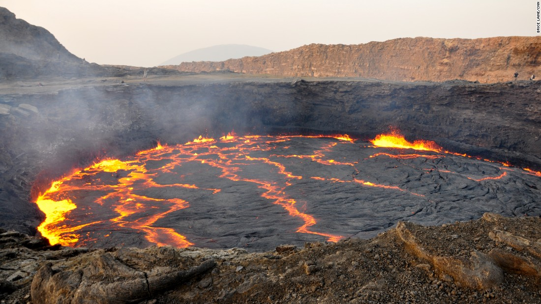 "Raw, immense and majestically beautiful, the Erta Ale volcanic crater also sits within the Danakil Depression. Known for being the world's oldest active lava lake, the locals call it ""the gateway to hell""."