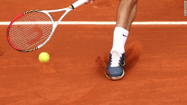 Roger Federer plays a forehand during during day one of the French Open at Roland Garros on May 26, 2013 in Paris, France.