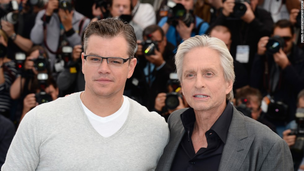 "Actors Matt Damon, left, and Michael Douglas attend the ""Behind The Candelabra"" premiere during the 2013 Annual Cannes Film Festival in France. Douglas starred as Liberace in the Steven Soderbergh-directed TV movie, which is based on Scott Thorson's 1988 autobiographical novel, ""Behind the Candelabra: My Life With Liberace."""