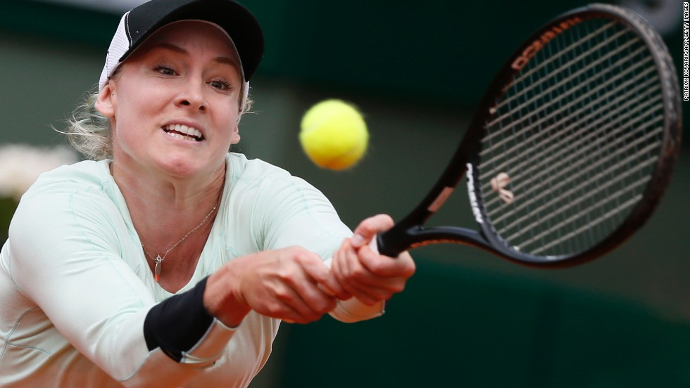 During a round of 16 match on June 3, the United States' Bethanie Mattek-Sands hits a return to Russia's Maria Kirilenko.