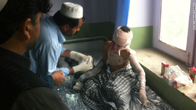 An injured student gets treatment after a suicide bomber blew himself up outside a school.