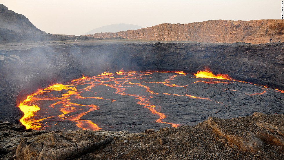 "Everything felt raw, imposing and beautiful, says CNN senior director Brice Laine of his recent trip to Ethiopia. Looking down into the Erta Ale volcanic crater was, he says, ""like witnessing the birth of Earth."" Located in the Danakil Depression and known as ""the gateway to hell"" among local Afar people, it's the world's oldest active lava lake."