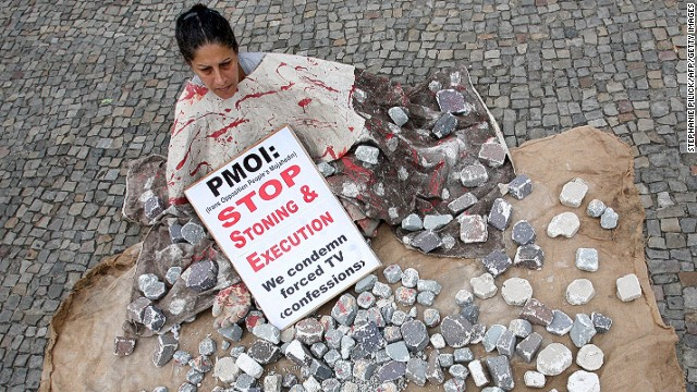 File: A woman demonstrates against stoning and execution on August 13, 2010 outside Berlin's landmark the Brandenburg Gate.